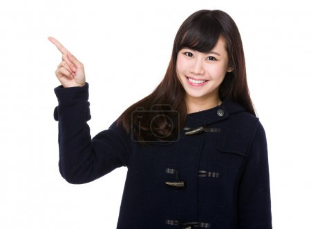 Photo for Young woman with finger pointing up - Royalty Free Image