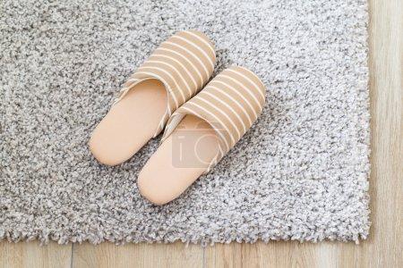 slippers on grey carpet