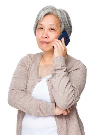Asian old woman in beige cardigan
