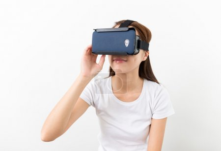 Photo for Asian young woman using the virtual reality headset - Royalty Free Image