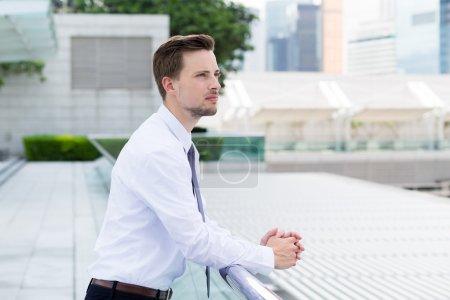 caucasian handsome businessman in white shirt
