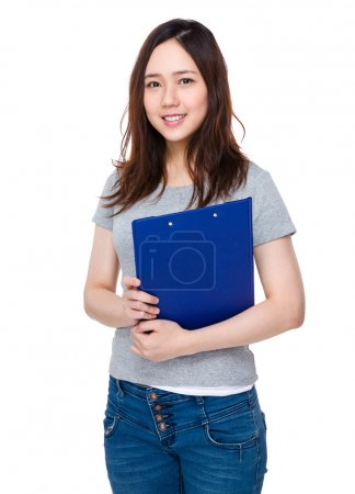 Asian young woman in grey t-shirt