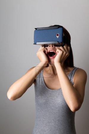 Woman using the virtual reality equipment
