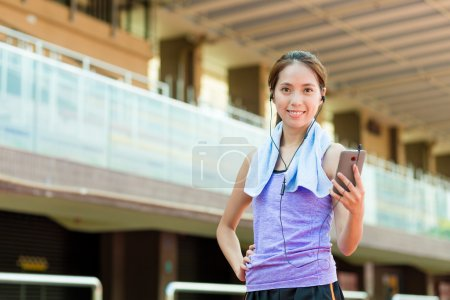 woman enjoy the music while doing exercise