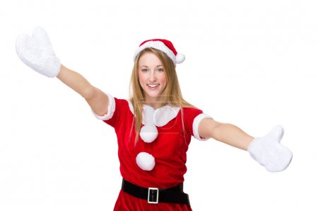 Photo for Woman with x mas costume with open arms for welcoming you - Royalty Free Image