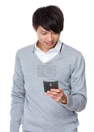 Asian young businessman in grey sweater