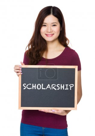 Photo for Asian woman in red t-shirt with blackboard and showing a word scholarship - Royalty Free Image