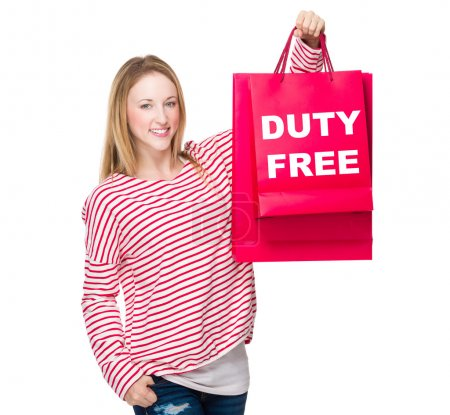 Woman in striped sweater with shopping bags
