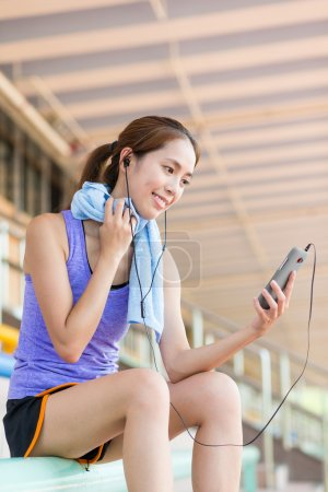 Woman with cellphone listen to music