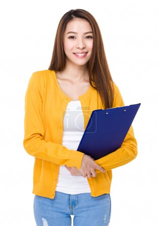 Asian young woman in yellow cardigan