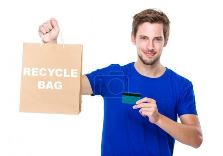 Man with shopping bag and credit card