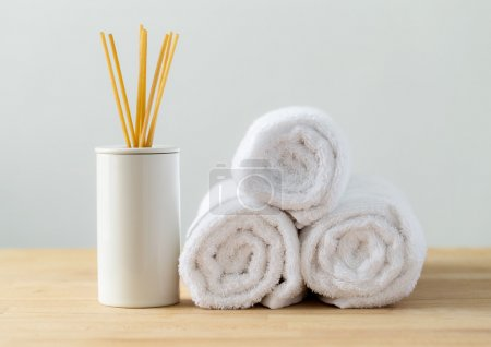 Photo for Scented sticks and white towels for spa - Royalty Free Image