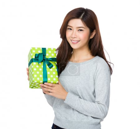 Photo for Asian young woman in grey sweater with present box - Royalty Free Image