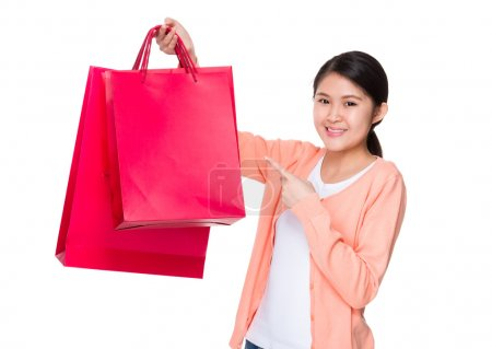 Asian young woman in pink cardigan