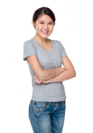 Photo for Asian young woman in grey t-shirt with arms crossed - Royalty Free Image