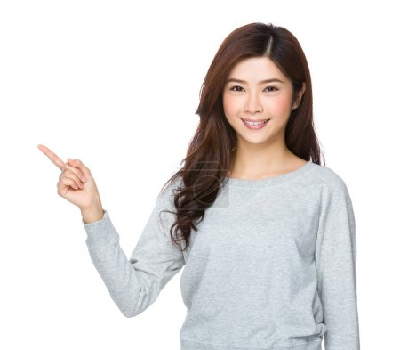 Asian young woman in grey sweater