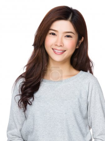 Photo for Asian young woman in grey sweater on white background - Royalty Free Image