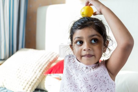 Photo for Indian little girl play with toy at home - Royalty Free Image