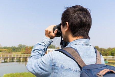 Young Man use of the binocular