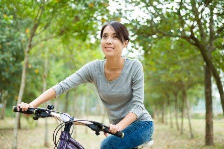 Woman enjoy riding a bike