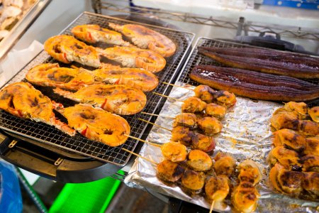 BBQ lobsters and scallops at fish market
