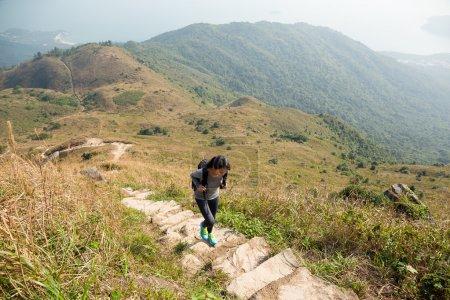 Asian woman hiker climb mountain