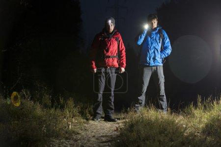 Hikers standing in field