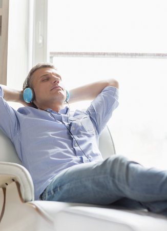 Middle-aged man listening to music
