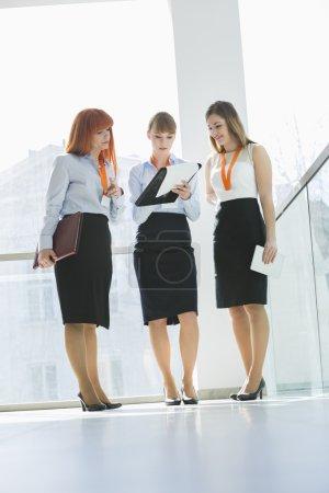 Businesswomen doing paperwork
