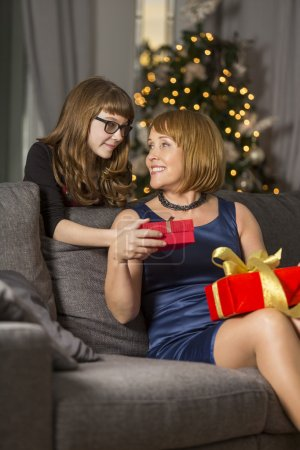 Daughter giving  present to mother
