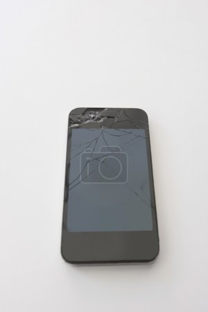 Photo for Smart phone with cracked screen over white background - Royalty Free Image