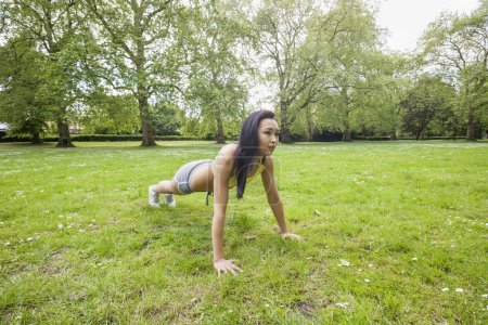 Woman performing pushups