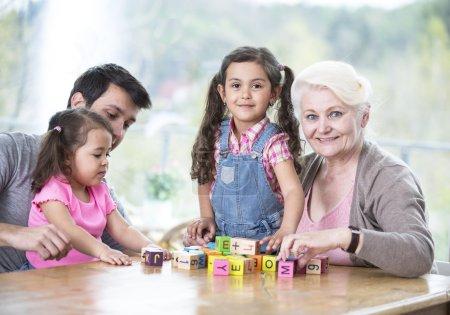 Three generation family playing