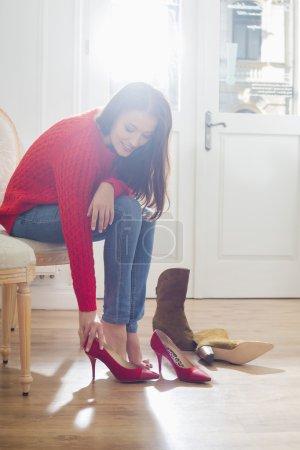 Woman trying on footwear