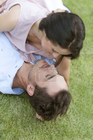 Couple lying together in park