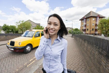 businesswoman answering cell phone