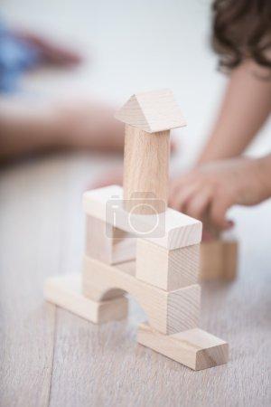 wooden tower on hardwood floor