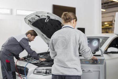 Mechanics working in repair shop