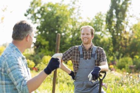 gardeners talking at plant nursery