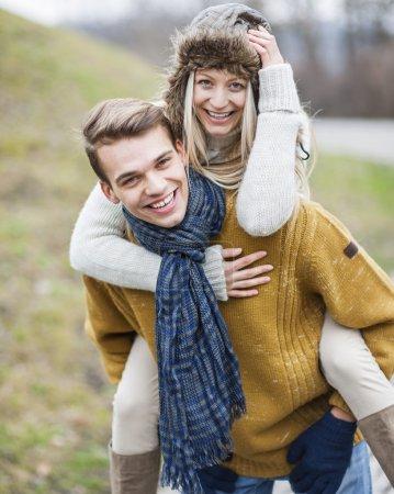 Man piggybacking woman