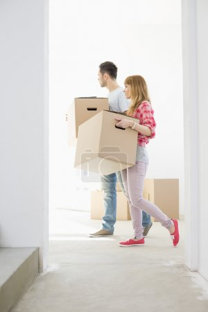 Photo for Couple carrying moving boxes - Royalty Free Image