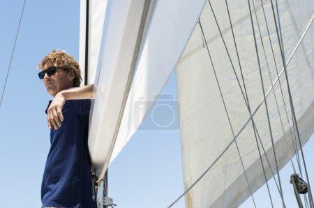 Man standing  on yacht