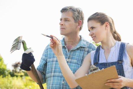 supervisor explaining something to gardener