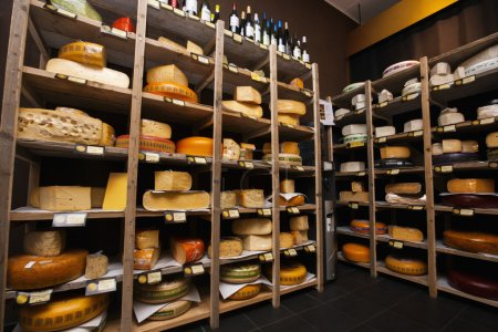 Cheese arranged on shelves