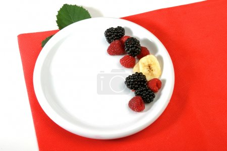 Berries on white plate