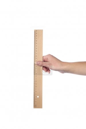hand holding wooden ruler