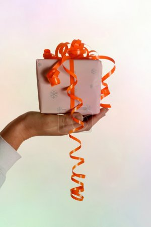 Woman hand holding a gift
