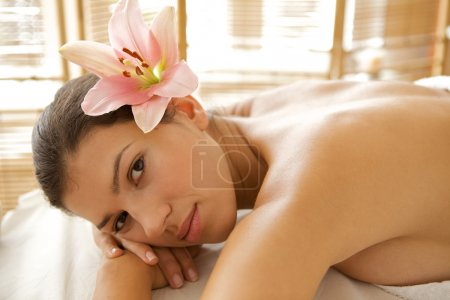 Woman relaxing on massage table