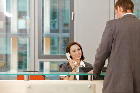 Photo for Young caucassian secretary assisting businessman - Royalty Free Image