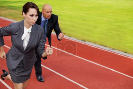 Businessman and woman on running